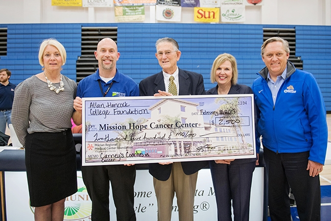 Allan Hancock College's Women's Assistant Basketball Coach Larry Carney (pictured center) presented a check for $2,500 to the Mission Hope Cancer Center at Hancock's annual Carney's Coaches vs. Cancer fundraiser. - PHOTO COURTESY OF ANDREW MASUDA